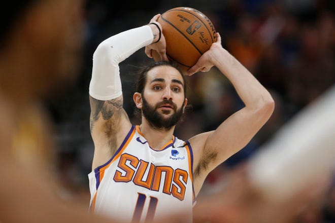 Phoenix Suns guard Ricky Rubio (11) passes the ball against the Utah Jazz in the second half during an NBA basketball game Monday, Feb. 24, 2020, in Salt Lake City. (AP Photo/Rick Bowmer)