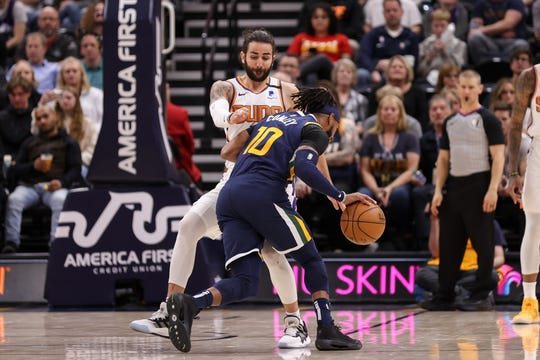 Feb 24, 2020; Salt Lake City, Utah, USA; Utah Jazz guard Mike Conley (10) runs into Phoenix Suns guard Ricky Rubio (11) during the fourth quarter at Vivint Smart Home Arena. The Suns won 131-111. Mandatory Credit: Chris Nicoll-USA TODAY Sports