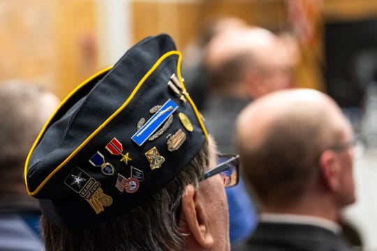 A veteran wears a decorated hat during a Board of Education meeting Monday, Feb. 24, 2020.