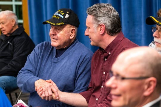 Brian Magsig, right, shakes hands with Jim Dickinson after he presented at the Board of Education meeting Monday, Feb. 24, 2020. Dickinson asked the board to put together a memorial for Magsig's grandfather, Roy Swanson, a former teacher who was killed in action on Feb. 12, 1951.