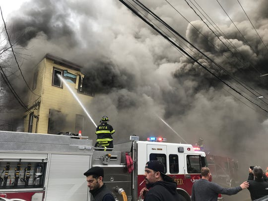 Smoke floods out of a Market Street building on fire in Wappingers Falls on Tuesday.