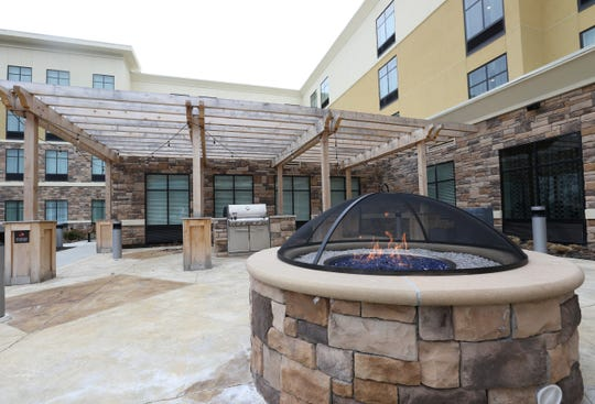 Outdoor barbecue and fire pits for guest use at the Homewood Suites by Hilton in the Town of Poughkeepsie on February 25, 2020.