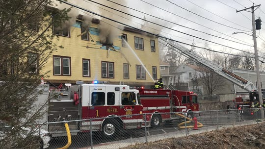Firefighters work to extinguish fire at 10 Market Street in the Village of Wappingers Falls on Tuesday, Feb. 25, 2020.