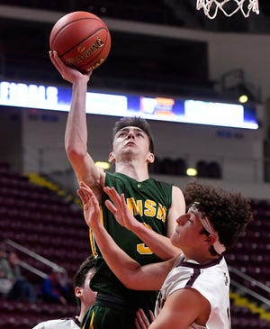 York Catholic's Benjamin Nelson-Moir drives the lane while covered by Christian Bingaman of Millersburg during the District 3 Class 2-A boys' basketball championship, Monday, February 24, 2020.