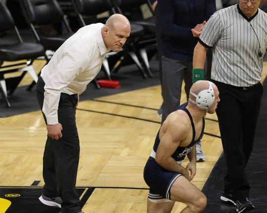 Jan 31, 2020; Iowa City, Iowa, USA; Penn State Nittany Lions head coach Cael Sanderson talks to Penn State Nittany Lions Jarod Verkleeren Luke Gardner (149) during his match against Iowa Hawkeyes Pat LugoÊ (149) at Carver Hawkeye Arena,  Mandatory Credit: Reese Strickland-USA TODAY Sports