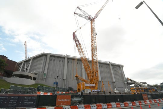 This 1,100-ton crane, one of the largest in the United States, has stood outside the Carrier Dome in Syracuse waiting to begin work. The next phase of a major renovation begins in earnest after March 1. The facility will reopen in mid-September for an SU football game against Colgate.