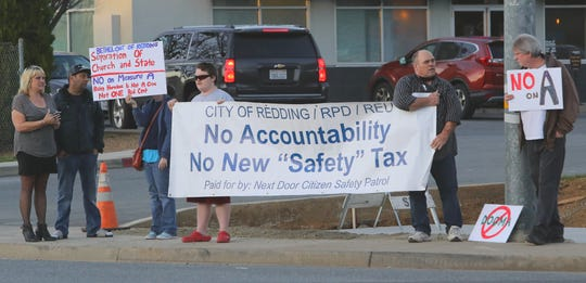 A small group of people demonstrated at the corner of Churn Creek Road and College View Drive on Monday, Feb. 24, 2020, to publicize three of their stands: No on the Measure A public safety tax; having a separation of church and state involving Bethel Church; and not criminalizing homeless individuals.