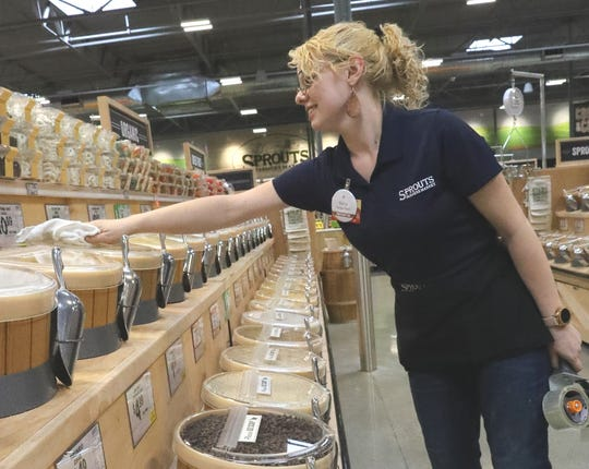 Sierra Johnson, bulk manager at the new Sprouts Farmers Market, prepares the bins on Tuesday, Feb. 25, 2020, ahead of Wednesday morning's opening at the Mt. Shasta Mall.