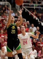 Oregon's Sabrina Ionescu (20) rebounds over Stanford's Lacie Hull, right, during the third quarter of an NCAA college basketball game Monday, Feb. 24, 2020, in Stanford, Calif.