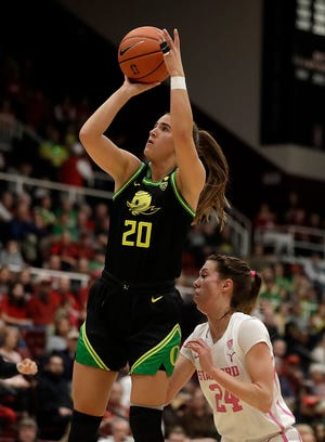 Oregon Ducks guard Sabrina Ionescu (20) shoots over Stanford's Lacie Hull, right, during the first half of an NCAA college basketball game Monday, Feb. 24, 2020, in Stanford, Calif.
