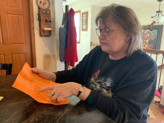 Sue Habeck, who lives next door to the proposed site, looked over her list of concerns and questions about the pit.
