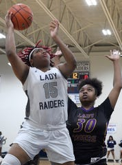 Huntington's Taylor Bell shoots over Westgate's Ahmariyan Turner in an LHSAA Class 4A state playoff game.