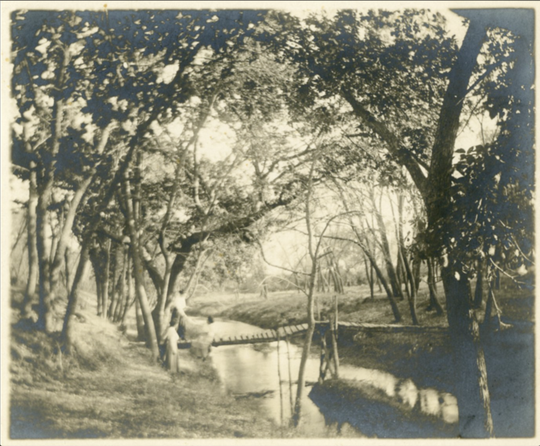 This image circa 1900 appears to show a footbridge over the western channel from the west bank of the Big Sioux River to Seney Island. The channel was later filled in and the island and channel lands became part of the land where Sioux Steel Company now operates.