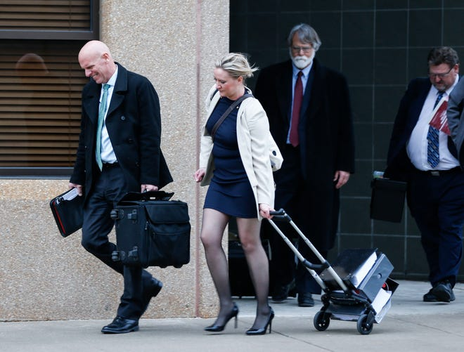 Dan Nash, left, and his legal team leave the federal courthouse in Springfield after a jury ruled in his favor on Feb. 25, 2020.