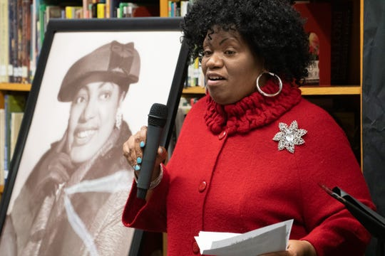 Christine Peoples speaks at Pershing Middle School's Black History & Culture Celebration on Monday, Feb. 24, 2020. At her left is a portrait of Springfield Route 66 entrepreneur Alberta Ellis.