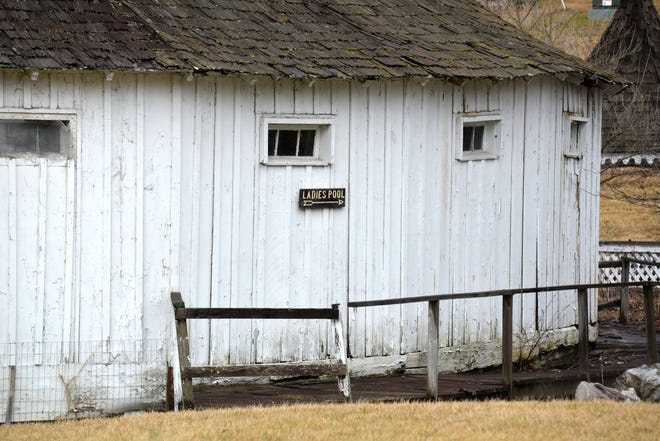 """A sign reads """"Ladies pool"""" attached to the ladies' bath house at the Warm Springs Pools in Warm Springs on Feb. 25, 2020."""
