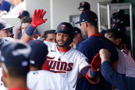 Minnesota Twins' Gilberto Celestino celebrates in the dugout after hitting a home run in the third inning of a spring training baseball game against the Boston Red Sox Monday, Feb. 24, 2020, in Fort Myers, Fla.