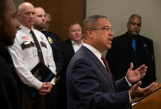 Minnesota Attorney General Keith Ellison, right, speaks about 28 recommendations and 33 action steps that are intended to reduce police-involved deadly force encounters at the Minnesota Department of Public Safety office Monday February 24, 2020 in St. Paul, Minn. (Jerry Holt/Star Tribune via AP)