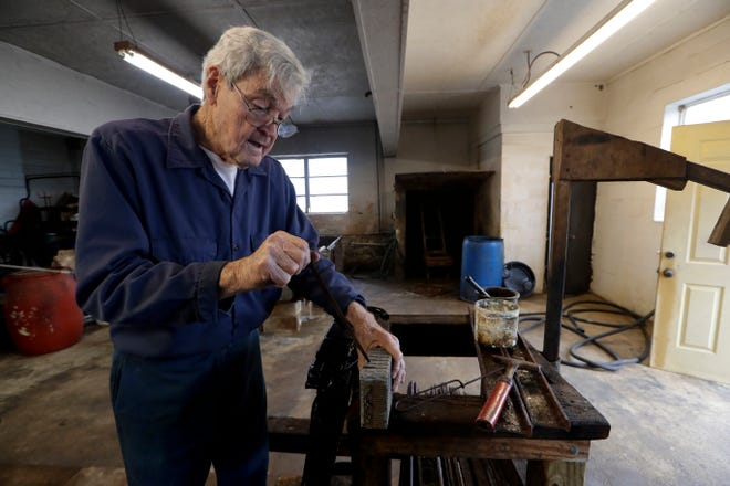 Ronald Trammel demonstrates how a radiator core works at Henry's Radiator Shop Wednesday, Feb. 5, 2020.