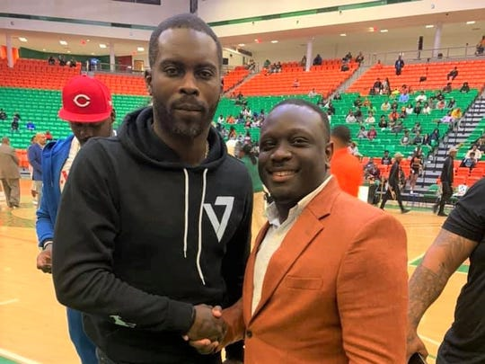 Michael Vick poses with FAMU Director of Athletics Kortne Gosha while sitting courtside for a men's basketball game versus South Carolina State on Monday, Feb. 24, 2020.