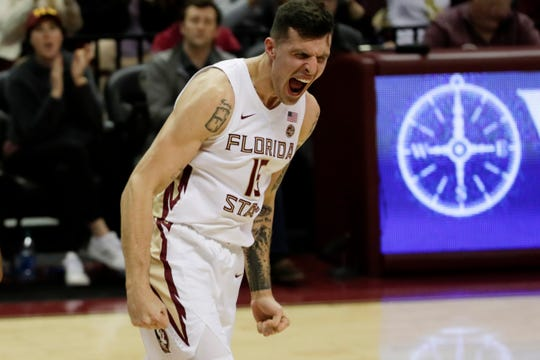 Florida State Seminoles center Dominik Olejniczak (15) celebrates a shot during a game between FSU and Louisville at Donald L. Tucker Civic Center Monday, Feb. 24, 2020.