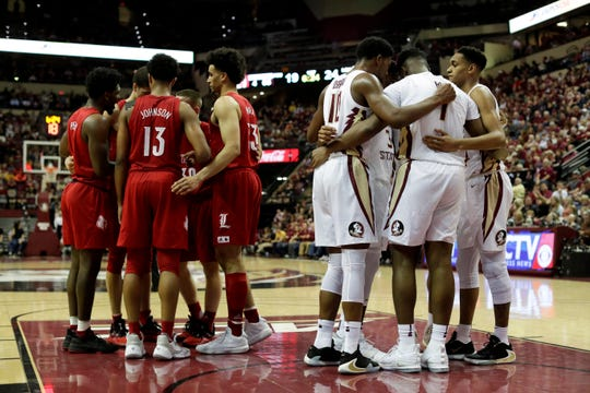 Florida State University and Louisville huddle up during a game at Donald L. Tucker Civic Center Monday, Feb. 24, 2020.