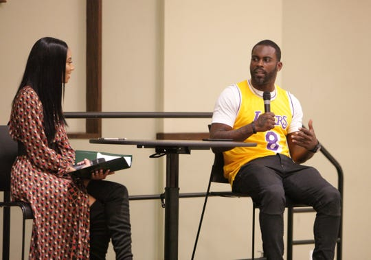 Former NFL quarterback Michael Vick talks with Robyn Seniors during his visit to the FAMU Grand Ballroom as part of his nationwide Empowerment Tour on Monday, Feb. 24, 2020.