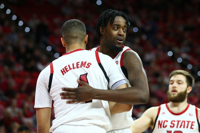 Senior forward D.J. Funderburk, center, is one of five key returners for the N.C. State men's basketball team this season. The Wolfpack has won 20 or more games in three consecutive seasons.