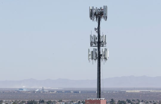 Cellphone towers rise from the landscape around El Paso.