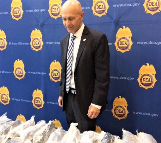 Kyle W. Williamson, special agent in charge of the DEA El Paso Division, on Monday, Feb. 24, 2020, looks over a load of methamphetamine recently seized in El Paso.