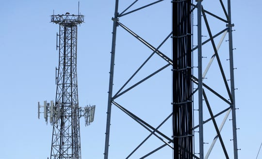 Cellphone towers rise above El Paso. Rules governing them might be changed.