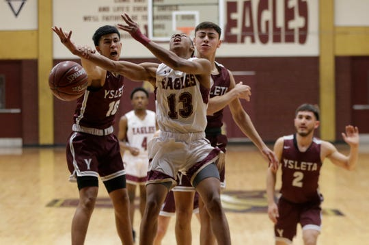 Andress guard Devonte Owens is fouled as he goes to the basket Monday against Ysleta.