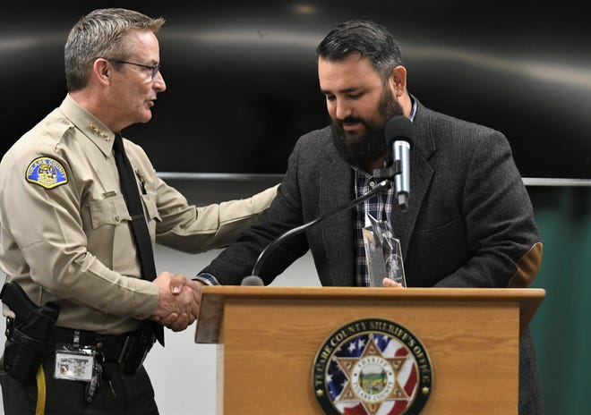Tulare County Sheriff Mike Boudreaux thanks Javier Ibarra on Tuesday, February 25, 2020.