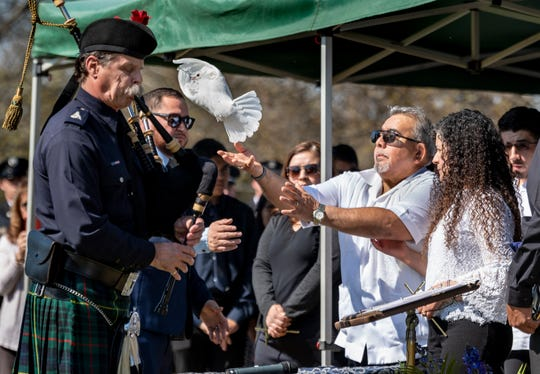 Ramon Figueroa releases a dove at the gravesite of his son Captain Ramon Figueroa as firefighters from across California came to Delano to pay their respects on Tuesday, February 25, 2020.
