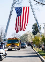 The procession for Captain Ramon Figueroa enters the cemetery as firefighters from across California pay their respects in Delano on Tuesday, February 25, 2020.
