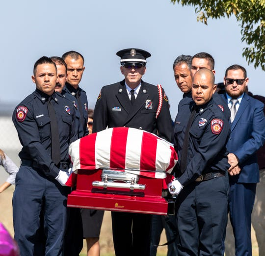 Pallbearers from Porterville Fire Department carry Captain Ramon Figueroa to gravesite as firefighters from across California pay their respects in Delano on Tuesday, February 25, 2020.