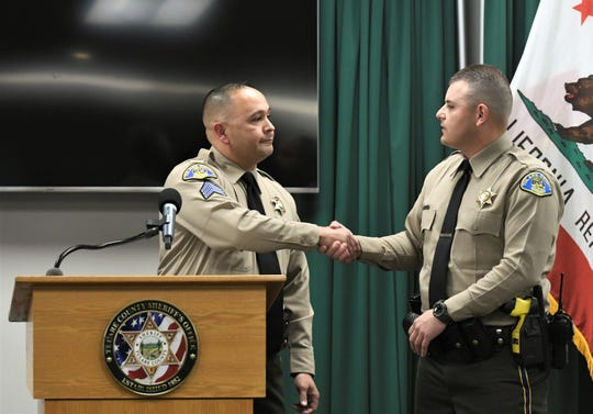 Sgt. Kenny Jones presents deputy Jonathan Banda with an employee recognition award during the STAR Award ceremony on Tuesday, February 25, 2020.