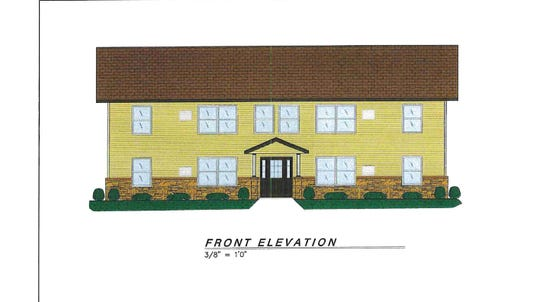 An 8-unit apartment building, proposed to replace the former Ponderosa Motel on Grand Avenue.