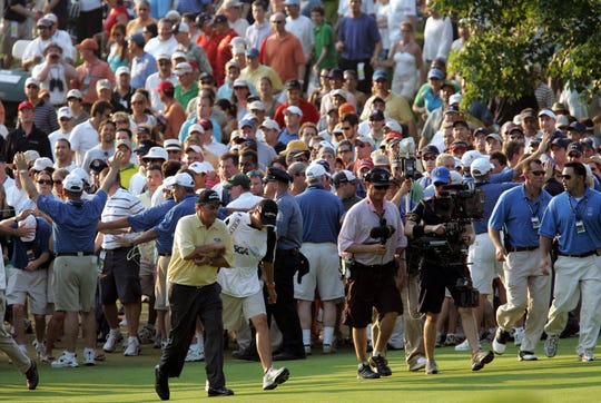 Phil Mickelson walks towards the 18th green during the U.S. Open Championship at Winged Foot Golf Club in Mamaroneck, June 18, 2006.