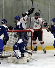 Horace Greeley's Jake Potter (15) celebrates one of his three goals during Greeley's 5-0 Section 1 Division 2 hockey quarterfinal win over Pearl River at Brewster Ice Arena Feb. 24, 2020.