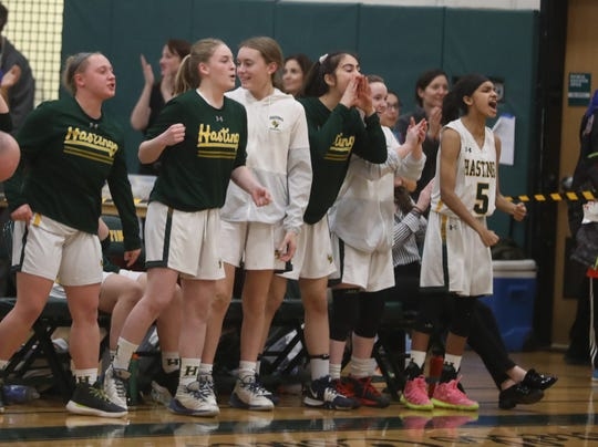 Hastings players celebrate the final seconds of a Section 1 Class B quarterfinal basketball game against Pleasantville at Hastings High School Feb. 24, 2020. Hastings defeated Pleasantville 57-53.