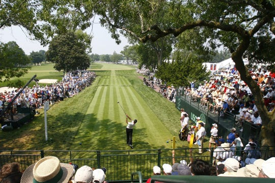 Geoff Ogilvy tees off on the first hole during action in the final round of the U.S. Open Golf Championship at Winged Foot Golf Club in Mamaroneck June 18, 2006.