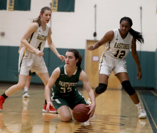 Mary Grace O'Neill of Pleasantville scoops up a loose ball as Lindsay Drozd and Paige Martin of Hastings pursue during a Section 1 Class B quarterfinal basketball game at Hastings High School Feb. 24, 2020. Hastings defeated Pleasantville 57-53.