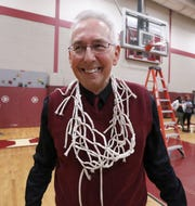Valhalla coach Richard Clinchy celebrates after cutting the net down after beating Briarcliff 60-57 in a Section 1 Class B basketball quarterfinal at Valhalla Feb. 24, 2020.