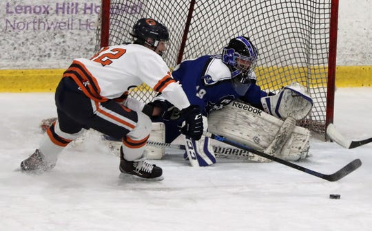 Horace Greeley's Gabe Adams is stopped by Pearl River goalie Aiden O'Connor during their Section 1 Division 2 hockey quarterfinal at Brewster Ice Arena Feb. 24, 2020. Greeley won 5-0.