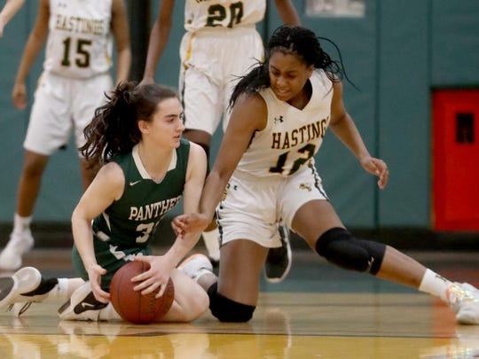 Paige Martin of Hastings battles Mary Grace O'Neill for the loose ball during a Section 1 Class B quarterfinal basketball game at Hastings High School Feb. 24, 2020. Hastings defeated Pleasantville 57-53.