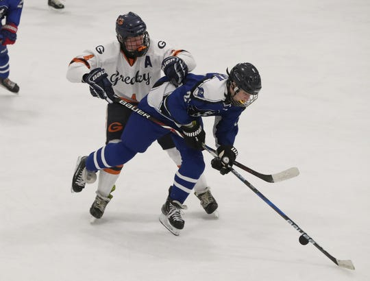 Horace Greeley's Tony Girardi, left, fights for the puck with Pearl River's Patrick Brown during their Section 1 Division 2 hockey quarterfinal at Brewster Ice Arena Feb. 24, 2020. Greeley won 5-0. 4 24
