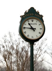 A clock with dormant trees at Winged Foot Golf Club in Mamaroneck Feb. 25, 2020 as preparations for the 2020 U.S. Open are underway.