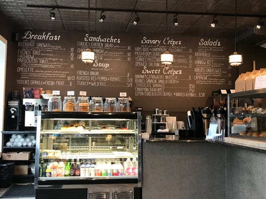 The menu of the new De La Coeur Café et Boulangerie in Independence Mall Shopping Center is listed on a blackboard behind the counter. There is also wait service in the 24-seat dining room.