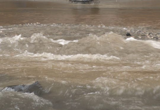 A water main break caused water to gush onto the roadway in downtown Wilmington. The city is resuming water disconnections Wednesday, June 8, 2021, after a suspending the practice last March for the pandemic.